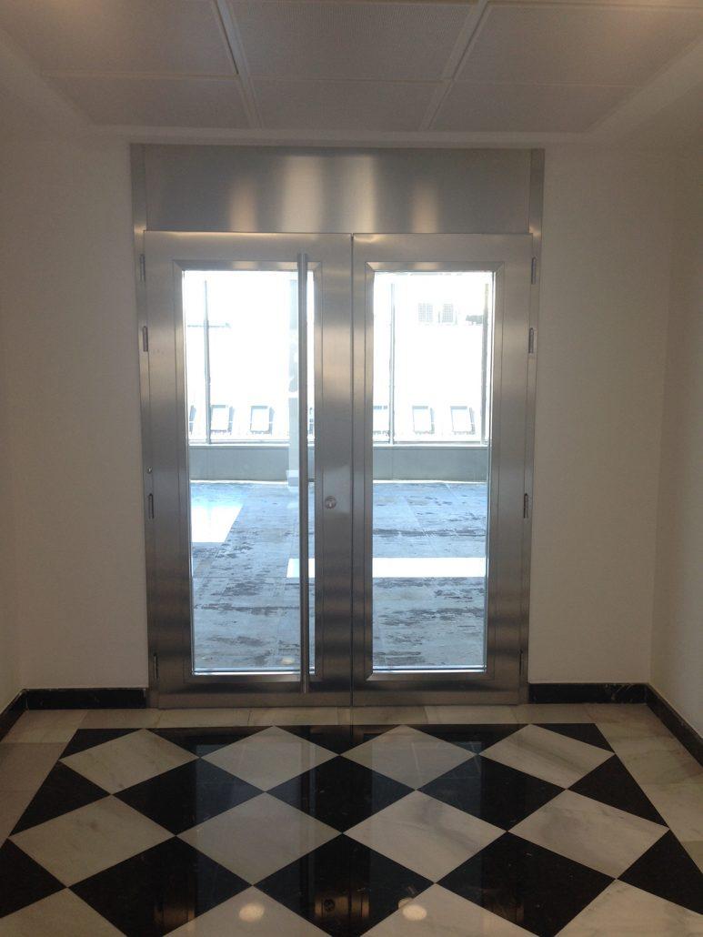 Danet Inoxidables - Puerta Vidriada Entrada Oficinas Doble Cortafuegos en Acero Inoxidable